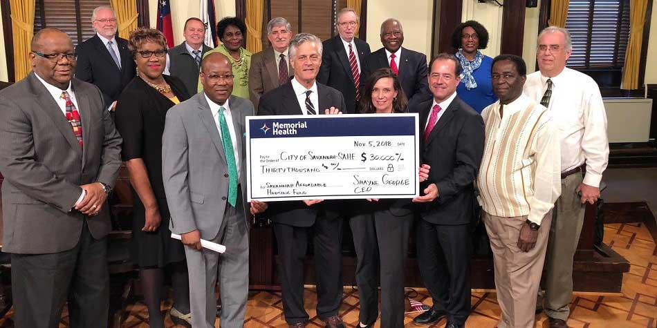 Memorial Health CEO Shayne George and VP of PR and Communications Becky Keightley present $30,000 check to Mayor Eddie Deloach and SAHF representatives at the City Council